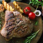 steak and potatoes with wine